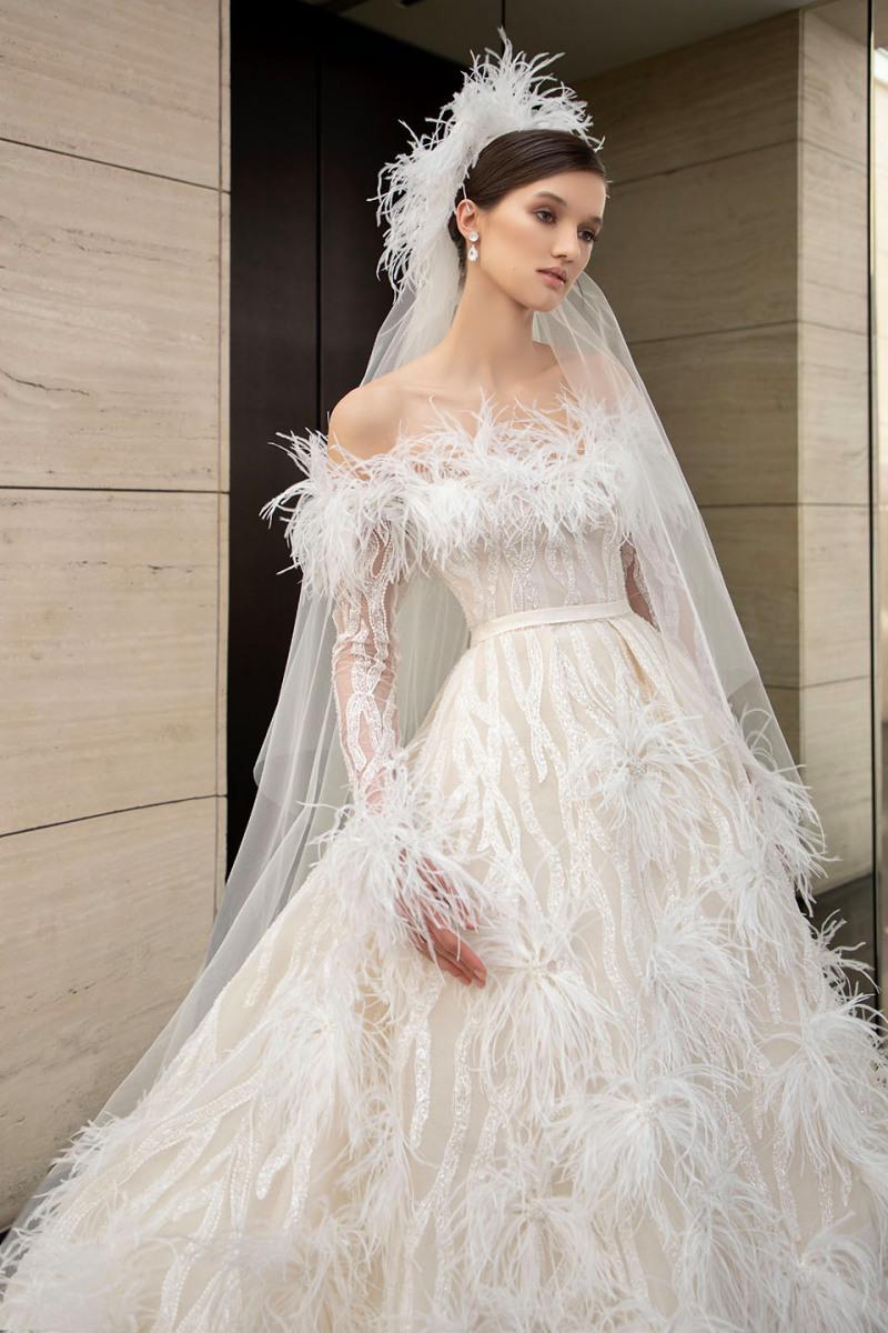 أحدث صيحات فساتين زفاف 2022.. إليكي التفاصيل بالصور